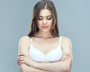 Beautiful woman portrait with breast. Female health concept.